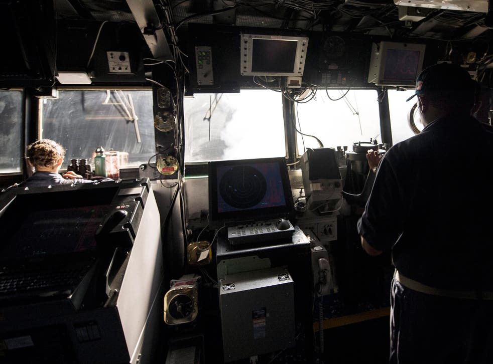 US navy sailors standing watch on the bridge while Tomahawk cruise missiles are launched against Isis targets in Syria, aboard the guided-missile cruiser USS Philippine Sea (CG 58), in the Arabian Gulf