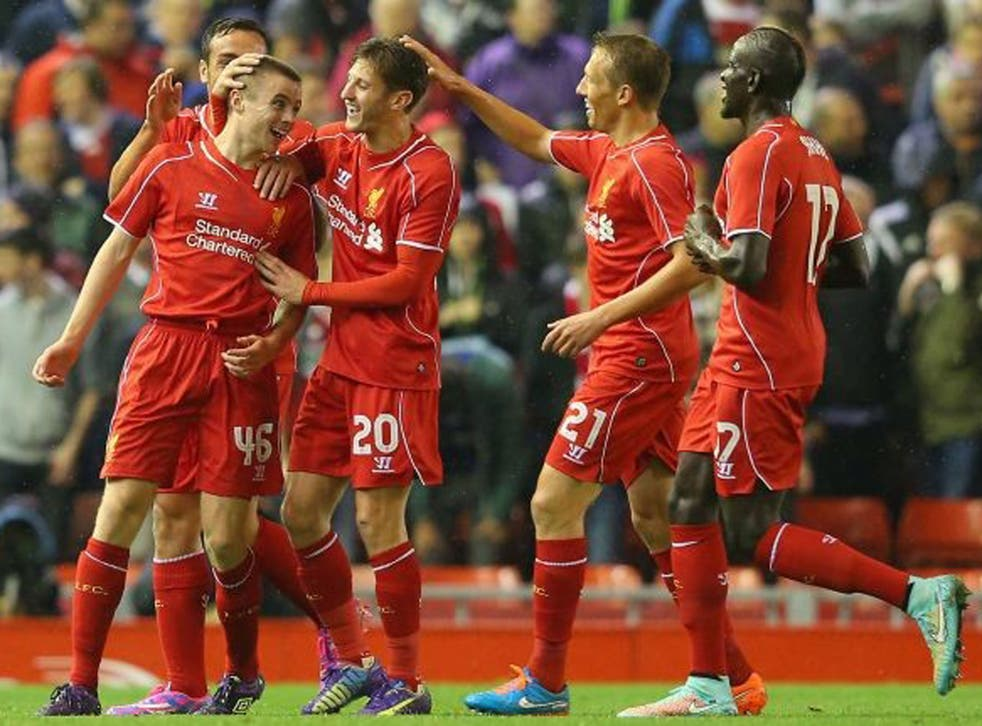 Jordan Rossiter celebrates with team mates after scoring the opening goal during the match between Liverpool and Middlesbrough at Anfield