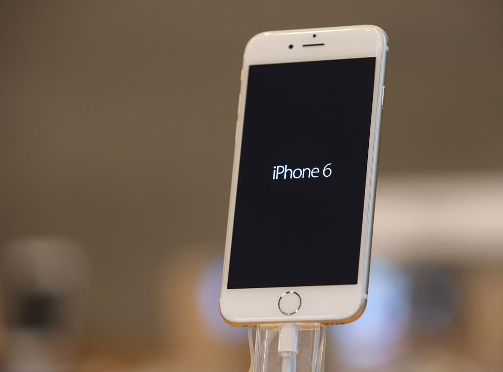 An Apple iPhone 6 stands on display at the Apple Store
