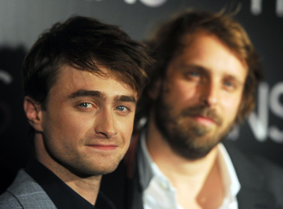 Daniel Radcliffe (L) and French director Alexandre Aja pose as they arrive for the premiere of their film Horns on 16 September
