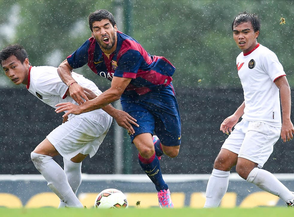 Suarez competes for the ball against an Indonesia U-19 side
