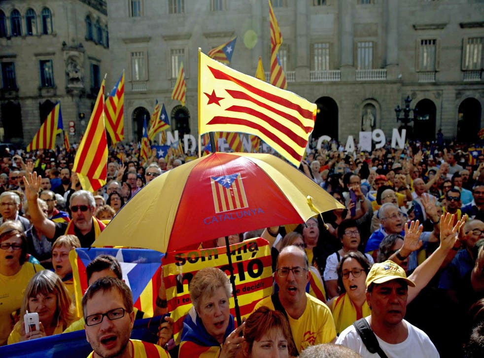 People gather in support of the referendum for independence at Sant Jaume Square in Barcelona on 27 September 2014