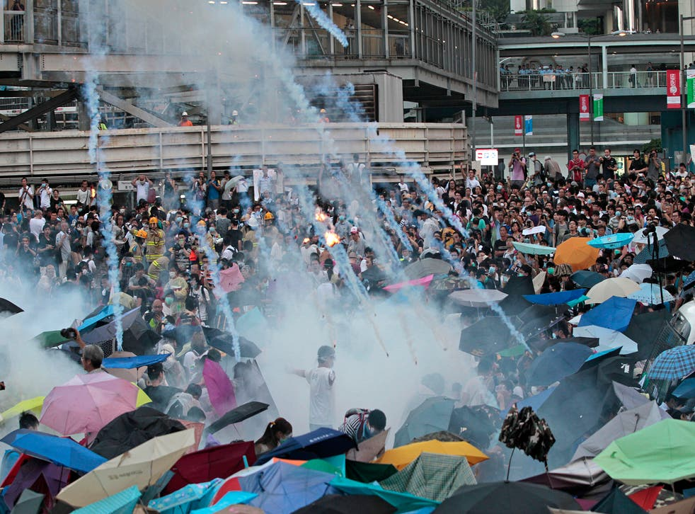 Tear gas is fired by police during a demonstration against China's decision not to allow a completely free election in Hong Kong in 2017