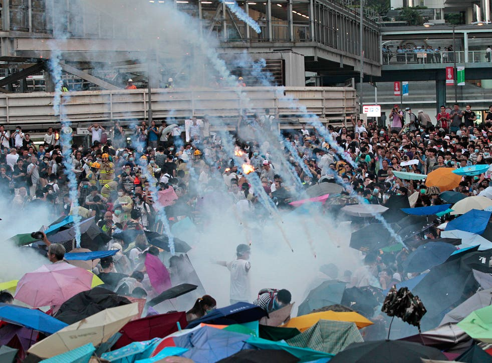 Images such as this one showing riot police launching tear gas into the crowd are raising the stakes of the face-off