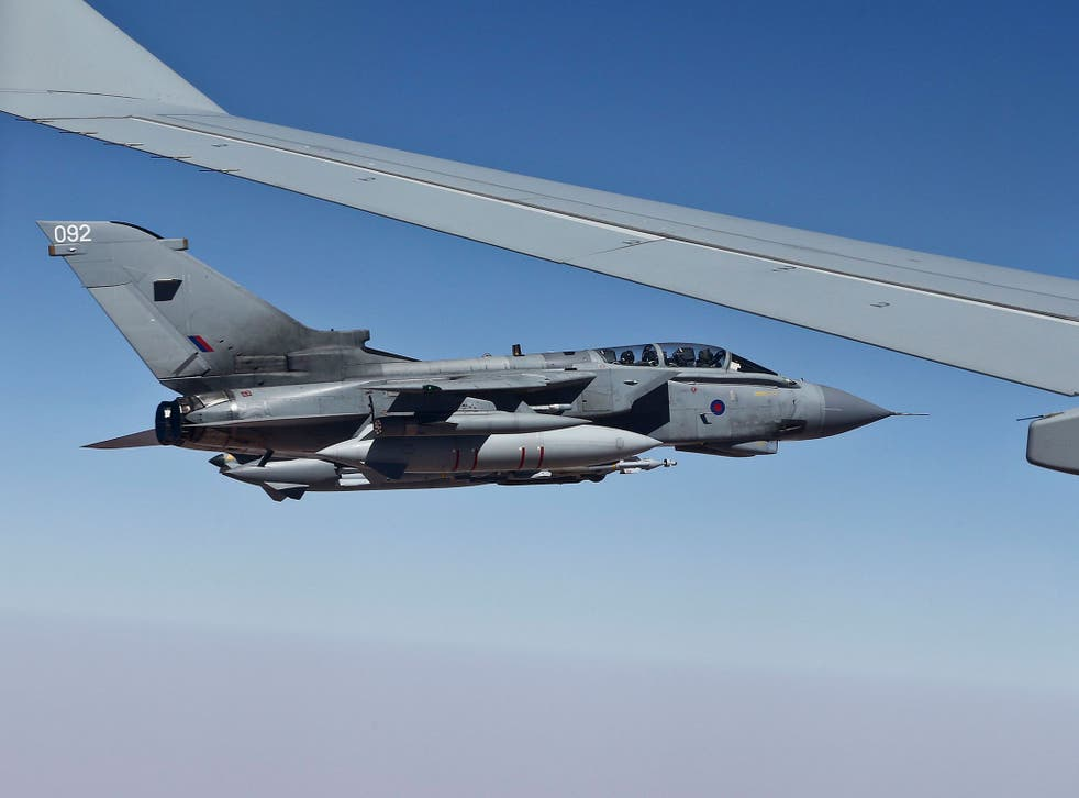 A Tornado GR4 alongside a Voyager refuelling aircraft during the RAF's first combat mission against Isis in northern Iraq