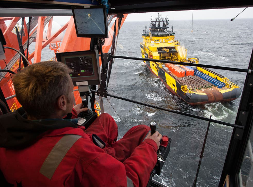 A worker controls arrival of a supply ship to the West Alfa drilling platform, which is anchored at the Cara Sea some 250 km (156 miles) north off Russian shore