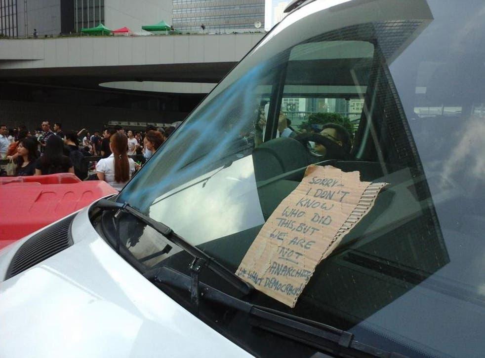An apology note left on a vandalised police van in Hong Kong