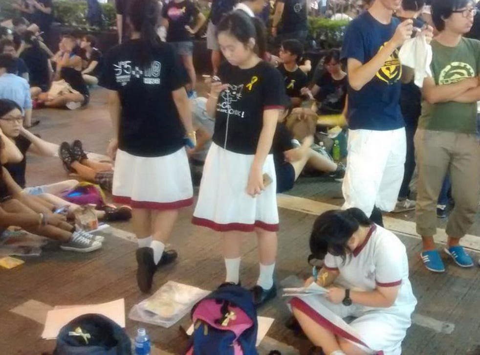Students doing their homework on Monday as protests continued in central Hong Kong
