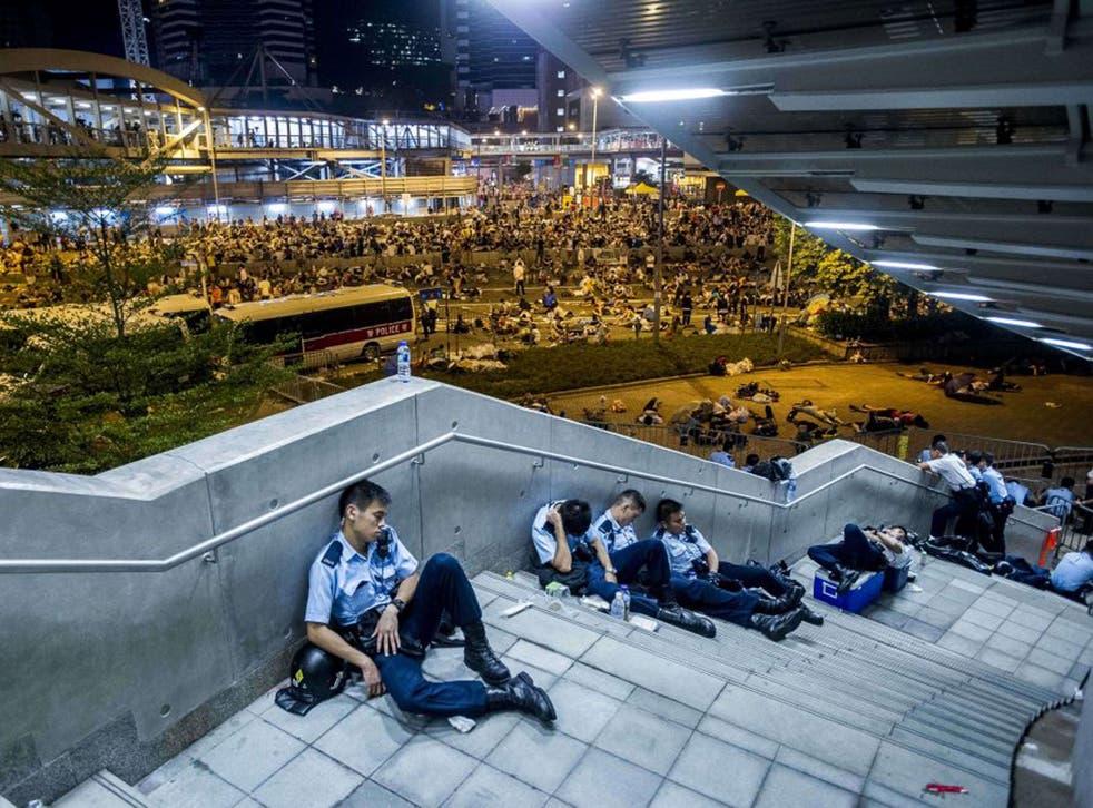 Riot police take a rest
