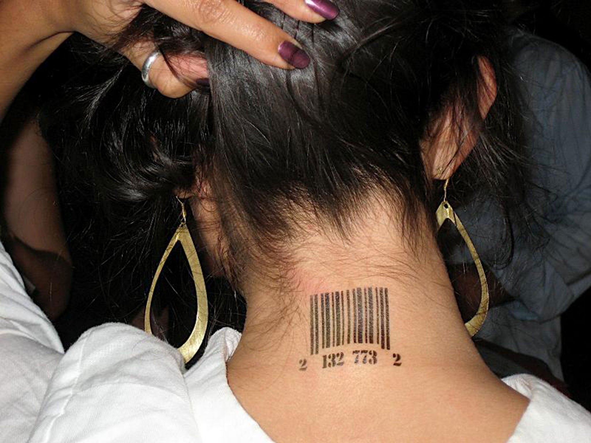 Human traffickers victims branded like cattle the for Pimp branding tattoos