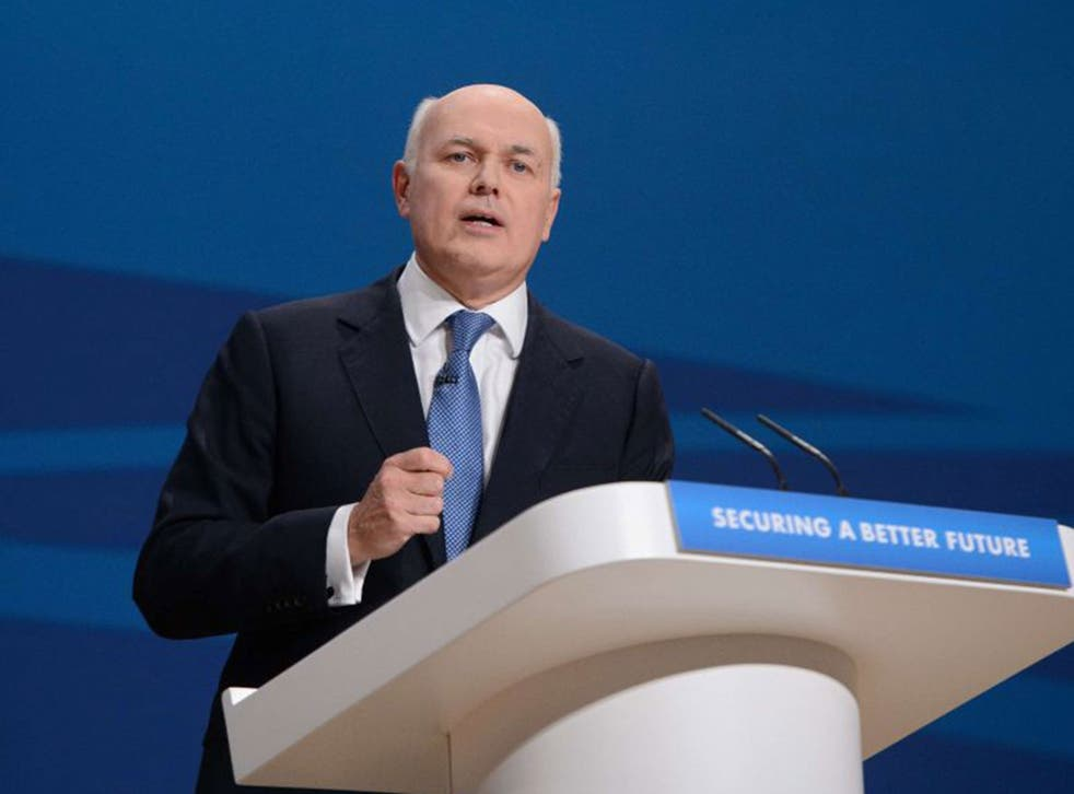 Iain Duncan Smith will soon introduce a scheme to control claimants' spending (AFP/Getty)