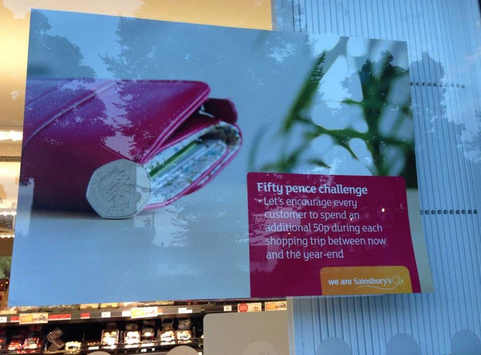 A poster telling staff at Sainsbury's to encourage customers to spend more was put up in the shop window instead of the staff room by accident