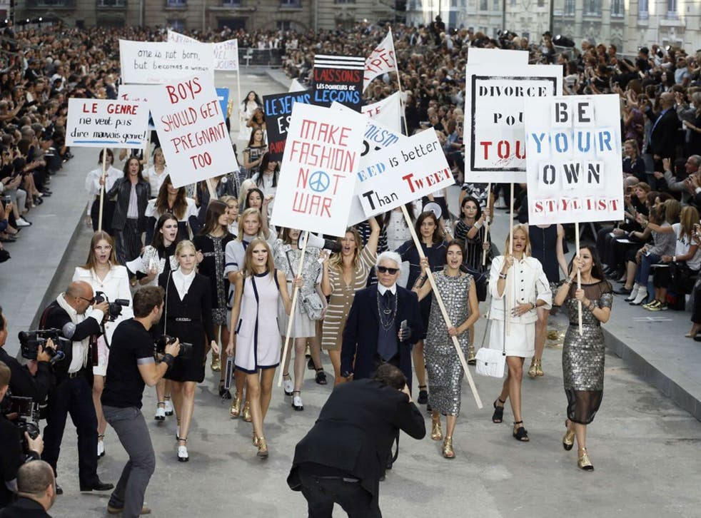 Karl Lagerfeld and Brazilian model Gisele Bundchen  lead the models the fashion riot at the finale of Chanel's show