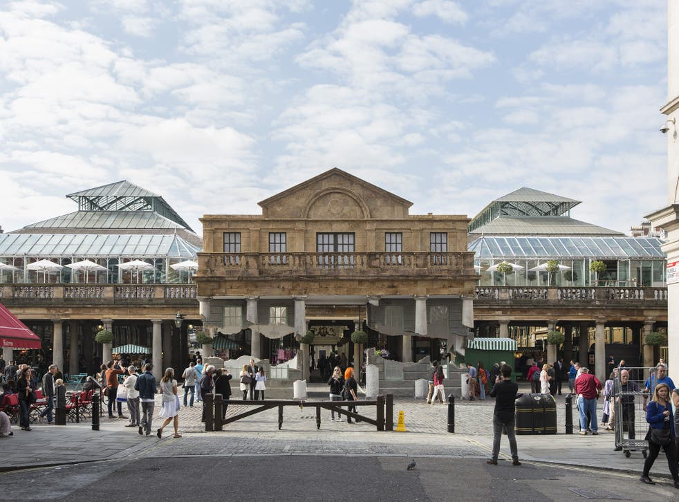 No bricks and mortar: Covent Garden's 184-year-old market building 'floating' yesterday