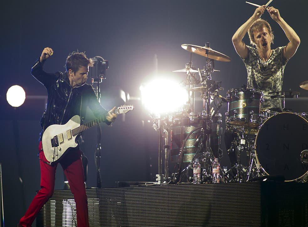 Muse's Matt Bellamy and Dominic Howard perform at the Amsterdam Arena in 2013