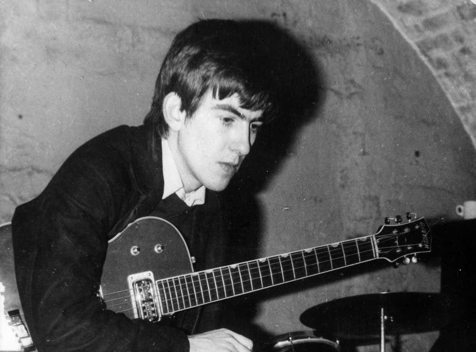 Circa 1960, a young George Harrison takes a break from playing at the Cavern, Liverpool