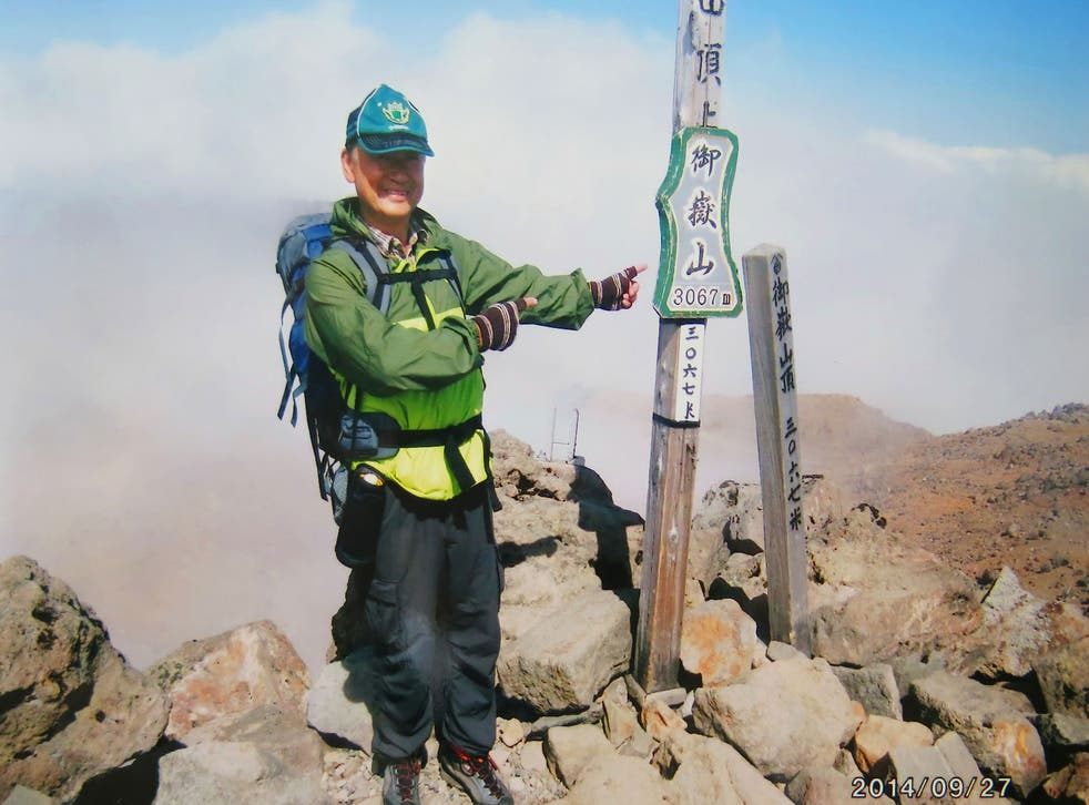 Izumi Noguchi poses on the summit of Mount Ontake shortly before the eruption