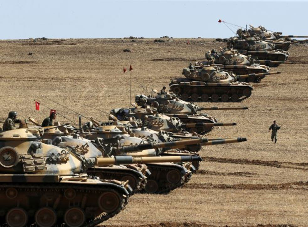 Turkish army tanks take up position on the Syrian border, but their presence is unlikely to have much bearing on the fate of Kobani, which is almost in the hands of Isis