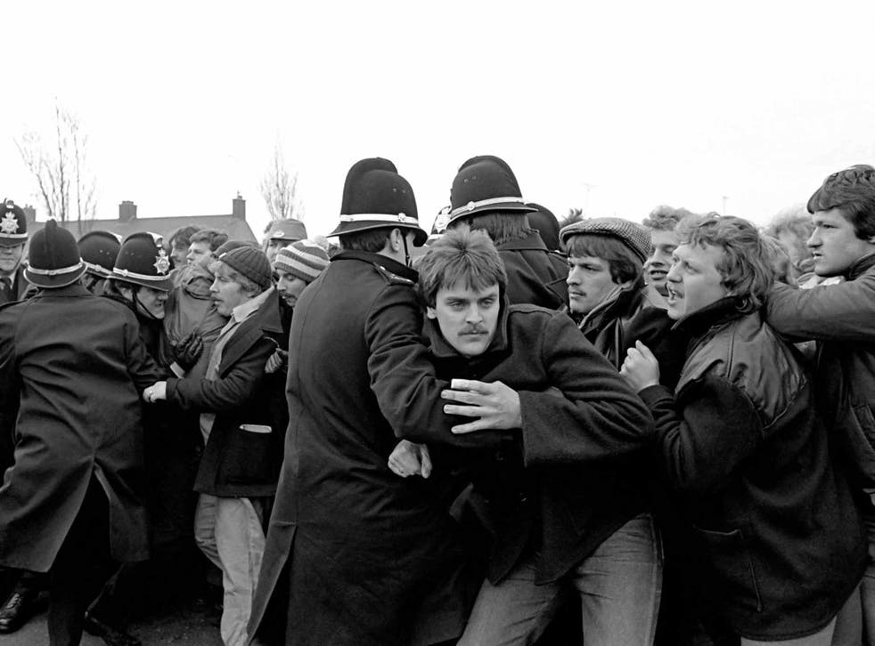Coal not dole: striking workers are held back by police on the picket line at the Port Talbot Steelworks, South Wales in 1984