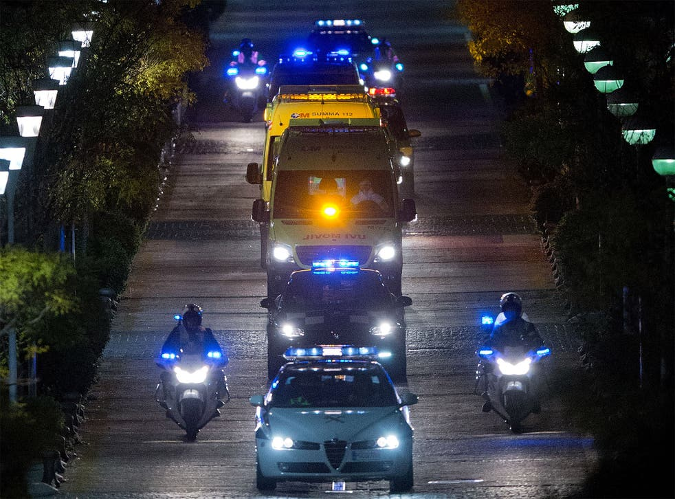 Police escort an ambulance carrying the Spanish nurse infected with Ebola to Carlos III hospital in Madrid