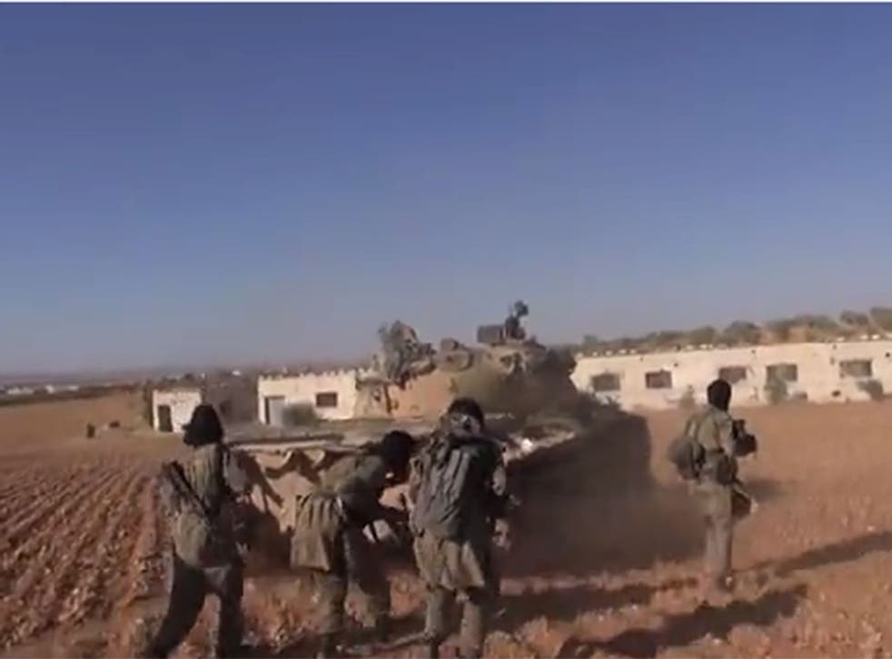 Isis fighters firing on targets on the besieged Syria-Turkey border town of Kobani