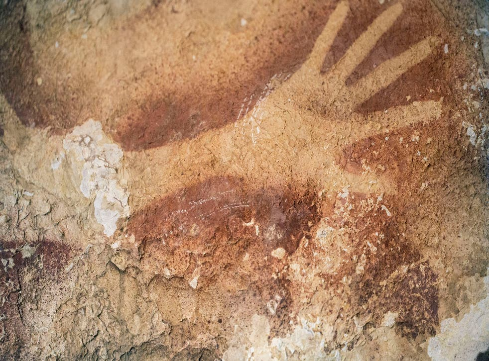 A hand stencil found in a cave in Indonesia, raising new questions about early mankind and the development of art in prehistoric times.