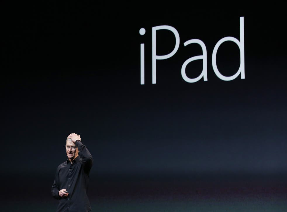 Apple Inc CEO Tim Cook, seen here introducing an iPad on 22 October 2013, is expected to unveil the firm's latest iPad offerings