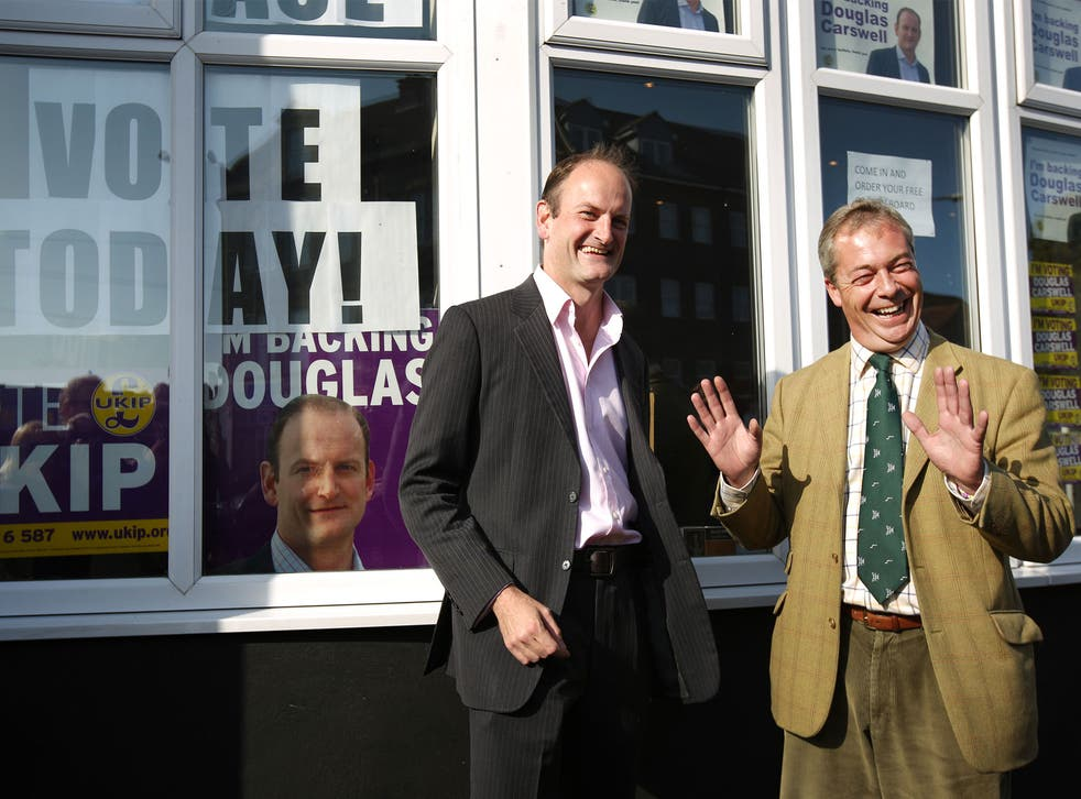 Douglas Carswell stands with Nigel Farage on October 9, 2014 in Clacton-on-Sea, England.