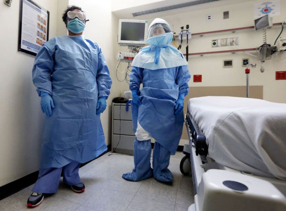 Ebola doctors wearing protective clothing in an emergency room.