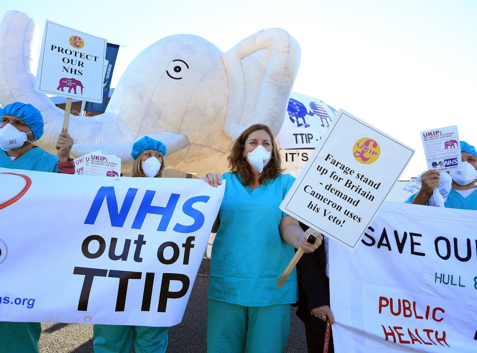 Health campaigners protest about the party's silence over the Transatlantic Trade and Investment Partnership