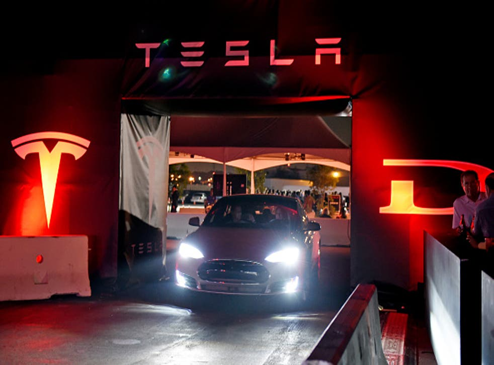 Tesla's new 'D' model car is unveiled in Los Angeles