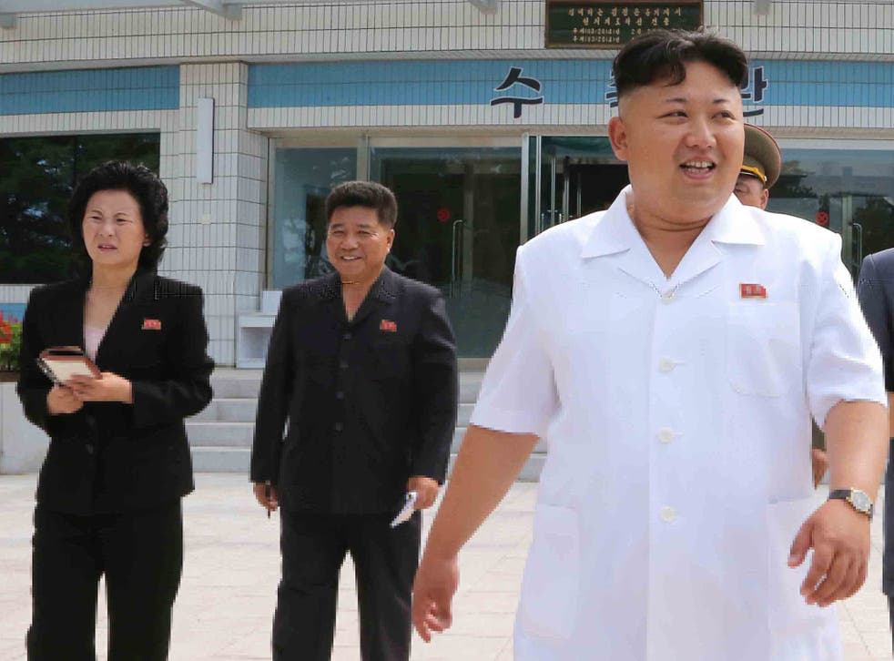 Kim Jong-un with his younger sister, Kim Yo-jong (left), on one of the leader's staged public appearances