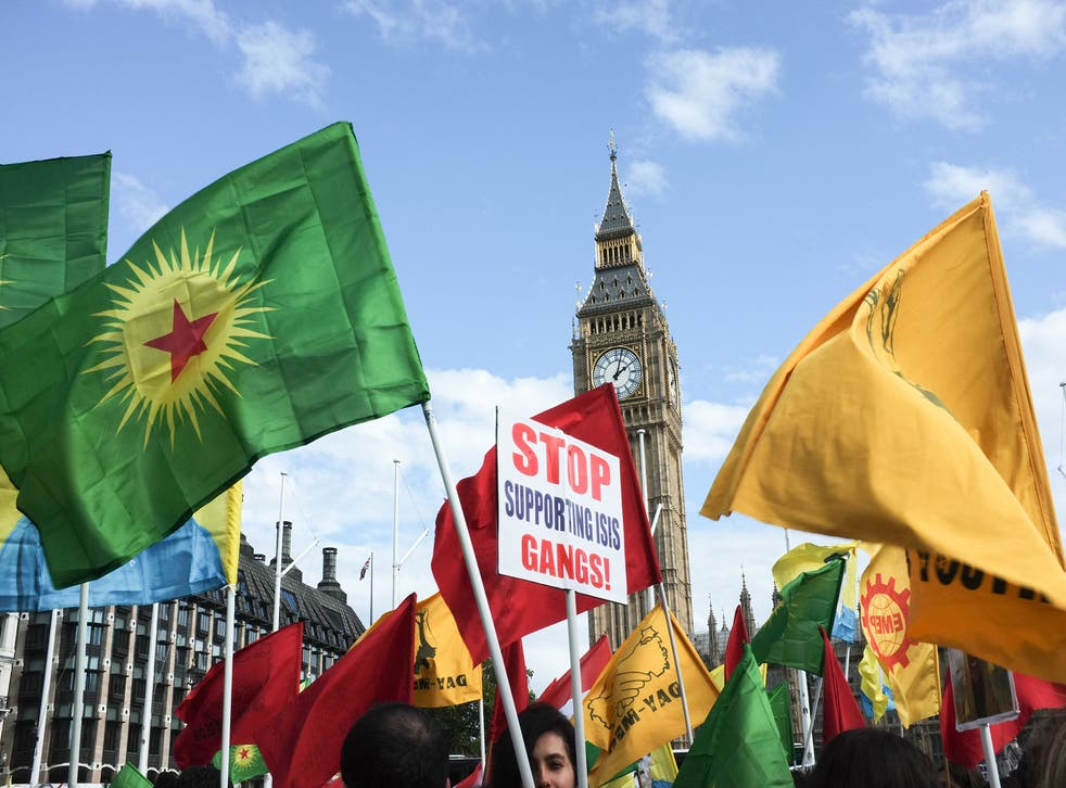 Thousands of people from London's Kurdish community turn out to protest against ISIS, in London