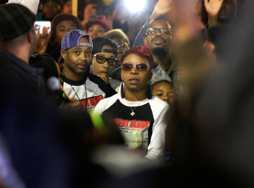 Lesley McSpadden, mother of Michael Brown, looks on at police during the 'Ferguson October' protests