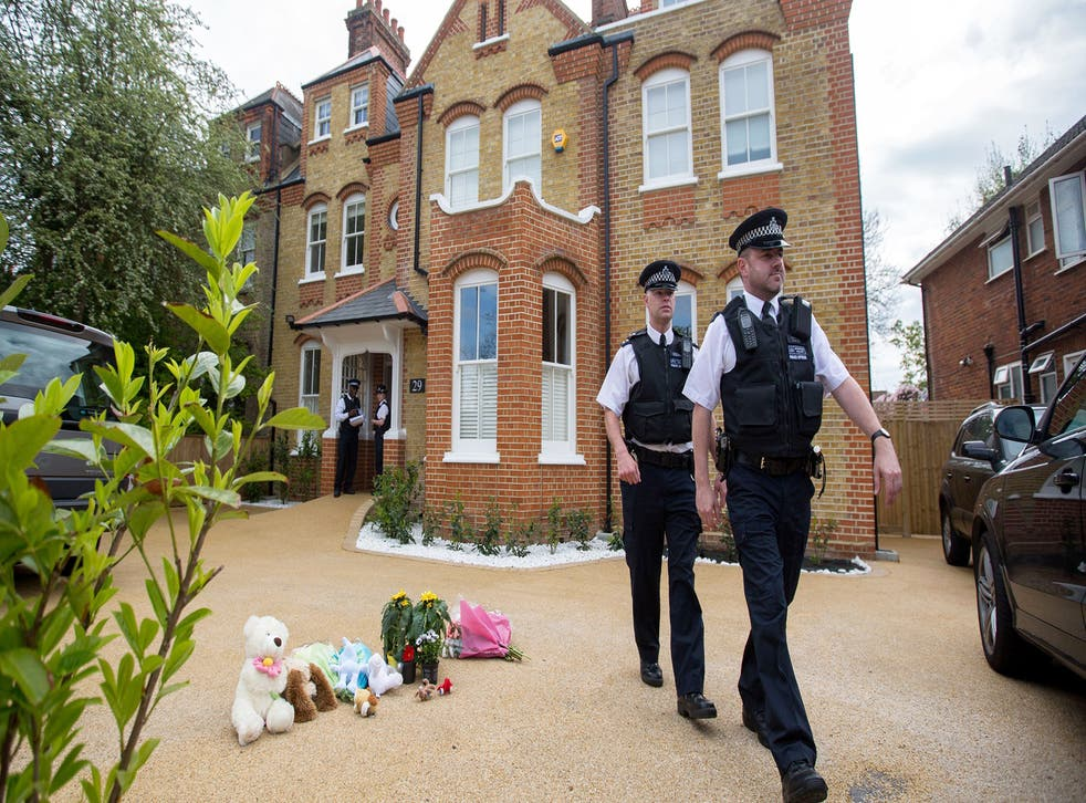 Police leave the New Malden home in April this year