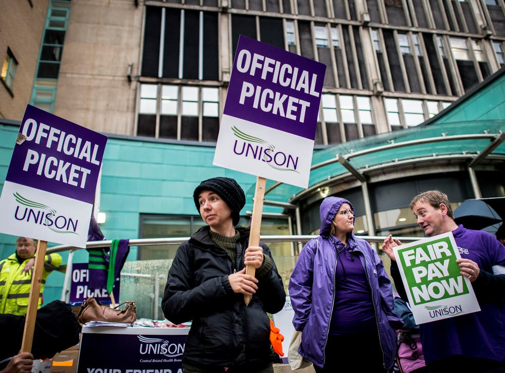 NHS workers picket outside the Bristol Royal Infirmary Hospital, Bristol, where staff are protesting against pay rise conditions