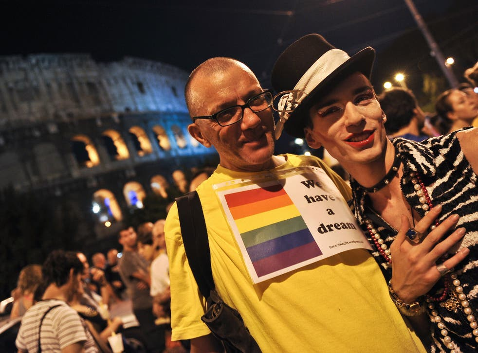 Italian gay rights supporters outside the Colosseum during a protest in 2009 against an increasing number of homophobic attacks