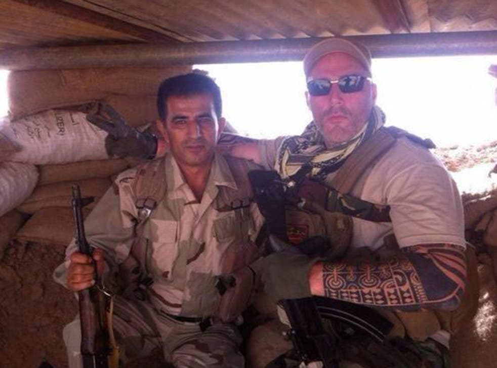 A man named as Ron pictured with a Kurdish fighter in Iraq
