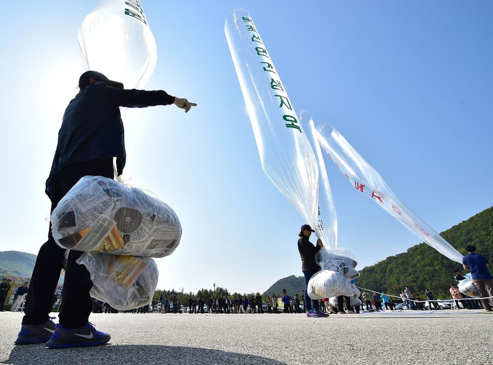 South Korean activists prepare to release balloons carrying anti-North Korea leaflets at a park near the inter-Korea border in Paju, north of Seoul