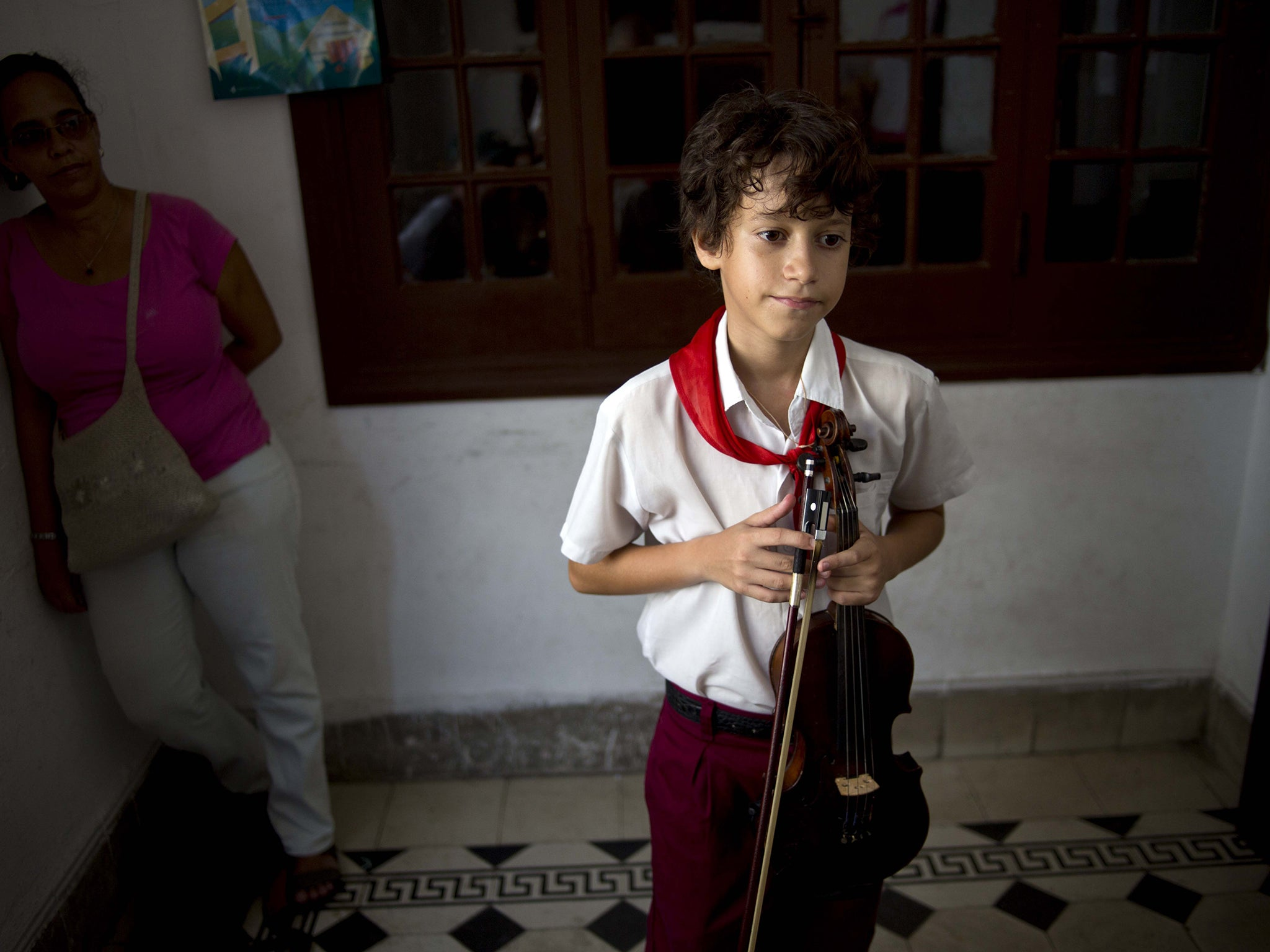 A young violinist takes a grades exam at a music school in the capital AP