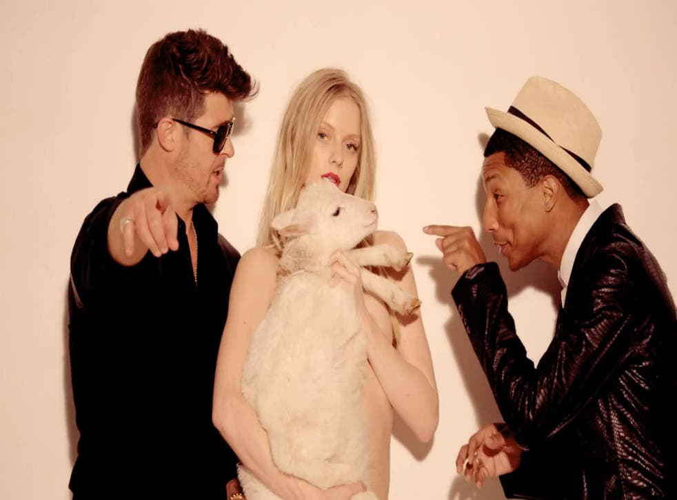 Robin Thicke and Pharrell Williams in the video for 'Blurred Lines'