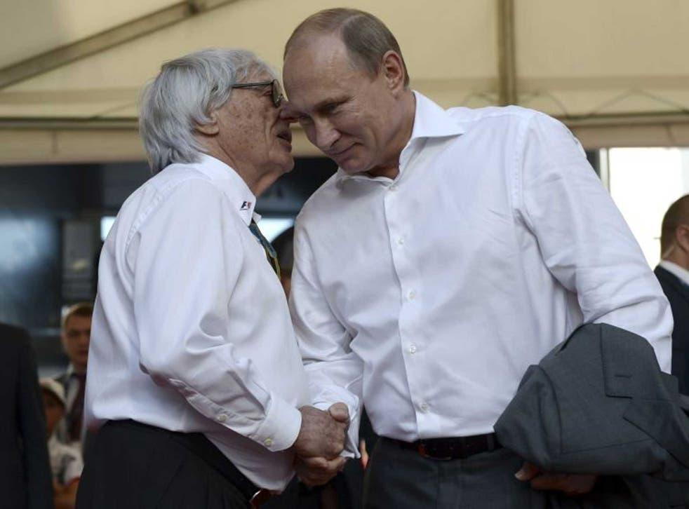 Bernie Ecclestone and Vladimir Putin greet at the Grand Prix