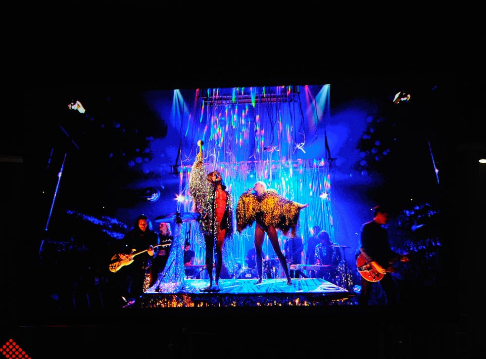 Wayne Coyne of The Flaming Lips performs with Miley Cyrus