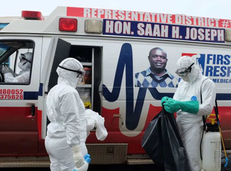 Saah Joseph's ambulance sits outside a hospital in Monrovia, Liberia. Joseph, a politician, imported six ambulances from California weeks before the Ebola epidemic hit his country, and six more are on the way