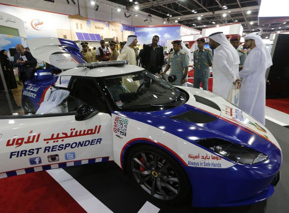 Visitors look at a first responder Lotus car at the Gitex Technology week in Dubai on October 15
