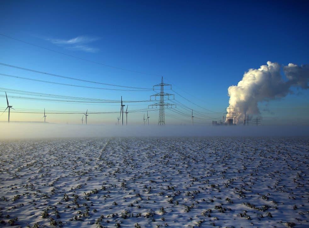 Smoke rises from the Niederaussem Power Station near Bergheim, western Germany