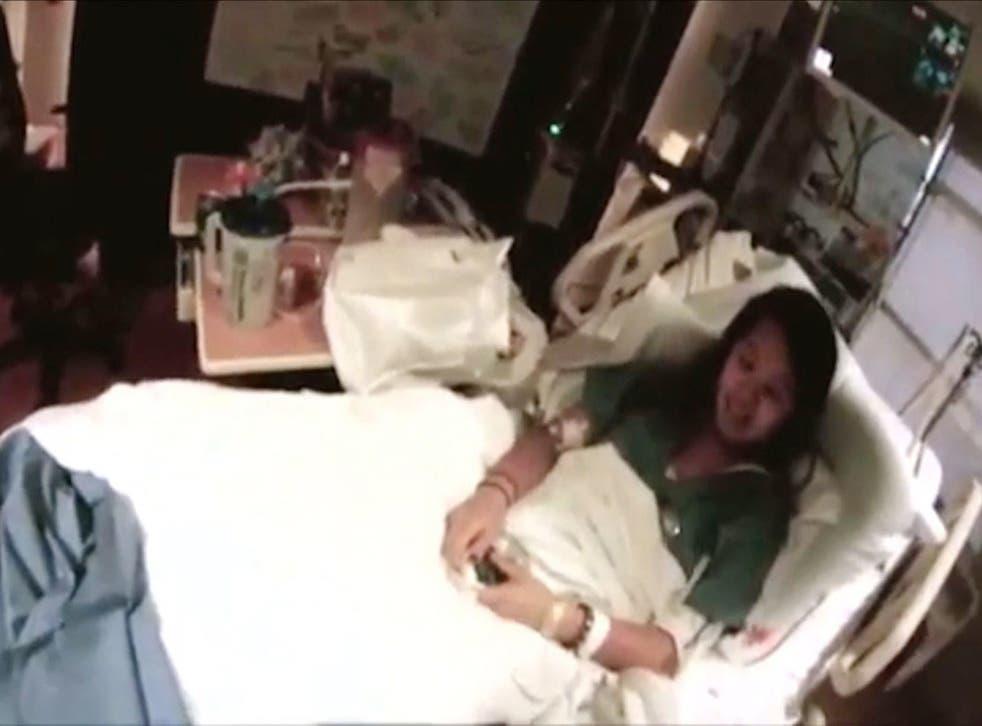 Nurse Nina Pham lies on her hospital bed at the Texas Health Presbyterian Hospital in Dallas, Texas