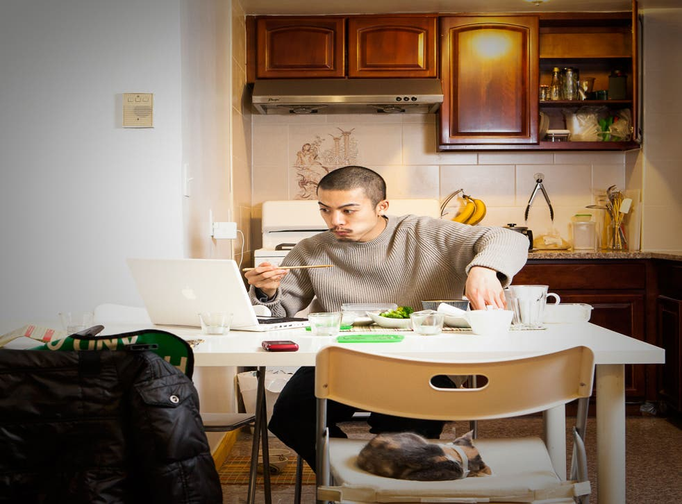 At 1.20am, after an intensive practice session, drummer Garro Heedae eats at his kitchen table in Vinegar Hill, Brooklyn, New York, with a computer screen and cat for company