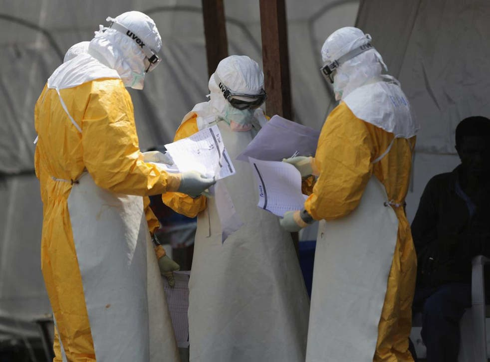 Health workers at Doctors Without Borders (MSF), work in the high-risk area of the ELWA 3 Ebola treatment center in Liberia