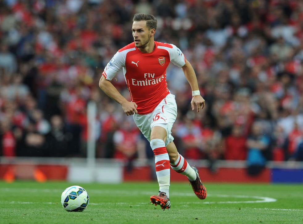 Aaron Ramsey runs with the ball during Arsenal's 2-2 draw with Hull on Saturday